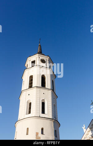 Tower near the St. Stanislaus Cathedral on Cathedral Square in old city of Vilnius against blue sky, Lithuania. - Stock Photo