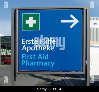 DEU, Federal Republic of Germany, Hannover: signpost, direction to a pharmacy and a first aid station. - Stock Photo