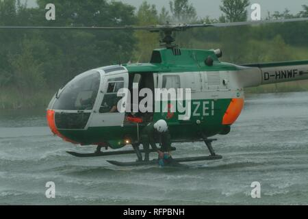 DEU, Germany, Duesseldorf: Rescue exercise, saving of people out of rivers or lakes. Police flying squad. Police helicopters. - Stock Photo