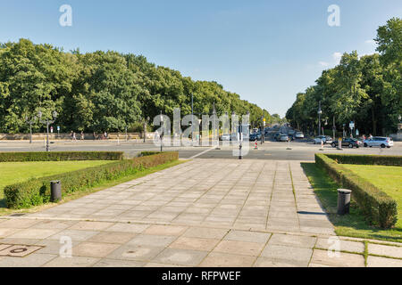 BERLIN, GERMANY - JULY 14, 2018: Street traffic on Hofjagerallee in Tiergarten park close to Victory column. Berlin is the capital and largest city of - Stock Photo