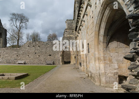 Valle Crucis Abbey was founded in 1201 as a Cistercian monastery and closed in 1537. The ruins are a prominent landmark near Llangollen North Wales - Stock Photo