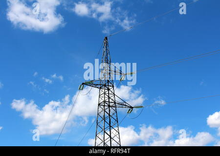 Electrical power line utility pole made of strong metal pipes with multiple electrical wires connected with glass insulators in front of cloudy blue - Stock Photo