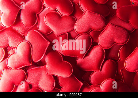 Red textile hearts closeup. Valentines day background, creative texture and love concept - Stock Photo