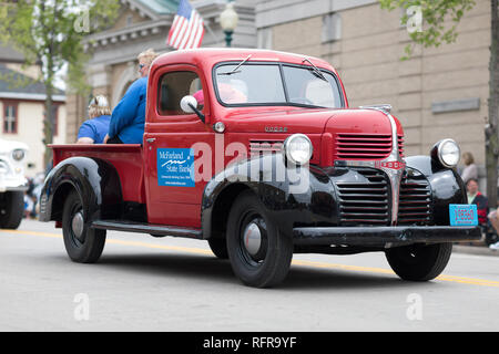 Stoughton, Wisconsin, USA - May 20, 2018: Annual Norwegian Parade, A Dodge Pickup truck, classic, going down the road during the parade - Stock Photo