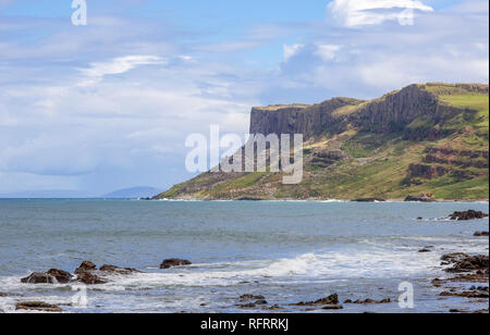 Famous Fair Head cliff on the Northern coast of County Antrim, Northern Ireland, UK. Sunset light - Stock Photo
