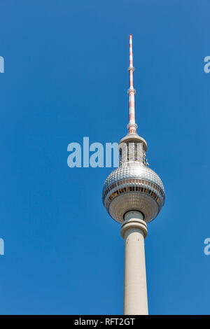 Berlin Tv Tower or Fernsehturm against clear blue sky, Germany. - Stock Photo