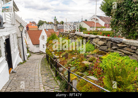 Stavanger's historic Old Town (Gamle Stavanger) with beautiful, traditional, white wooden houses. Stavanger, Norway - Stock Photo