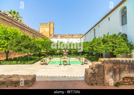 Orange trees and pool in the ancient courtyard Patio Morisco, Alcazar de los Reyes Cristianos, Cordoba, UNESCO World Heritage Site, Andalusia, Spain - Stock Photo