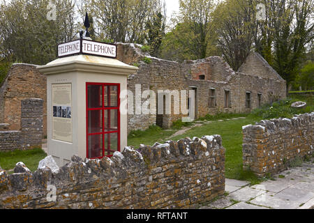 The abandoned ghost village of Tyneham showing the restored 1940s telephone booth, near Wareham, Dorset, England, United Kingdom, Europe - Stock Photo