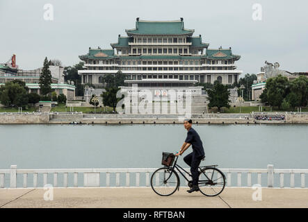 Grand People's Study House and Kim Il Sung Square, seen across Taedong River, Pyongyang, North Korea, Asia - Stock Photo