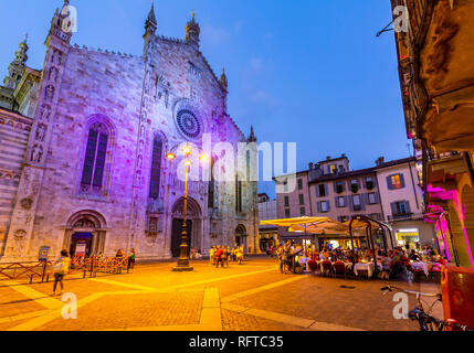 View of Duomo and restaurants in Piazza del Duomo at dusk, Como, Province of Como, Lake Como, Lombardy, Italy, Europe - Stock Photo