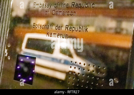 Berlin, Germany. 27th Jan, 2019. A police car is reflected in the sign of the Embassy of the Republic of Cameroon in Berlin-Westend. The Embassy of the Republic of Cameroon in Berlin-Westend was occupied on the night of Sunday. Credit: Christoph Soeder/dpa/Alamy Live News - Stock Photo