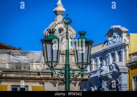 Vintage street lamps on the Commerce square, in Lisbon, Portugal - Stock Photo