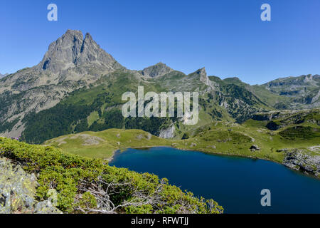 Lac du Miey and Pic Midi d'Ossau seen from the GR10 hiking trail in the French Pyrenees, Pyrenees Atlantiques, France, Europe - Stock Photo