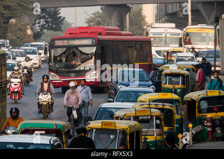 Traffic outside Dhaula Kuan metro station in New Delhi, India - Stock Photo