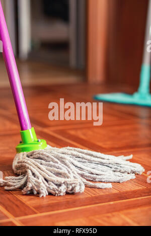 Rope mop for cleaning the floor is on the floor of the tile. - Stock Photo