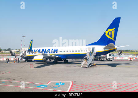 Ciampino, Italy - September 6, 2018: People passengers walking on steps boarding Ryanair airplane domestic European Union flight low-cost cheap airlin - Stock Photo