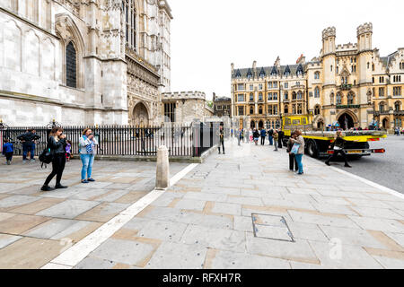 London, UK - September 12, 2018: Westminster Abbey with people and sidewalk by attorney general's office during day - Stock Photo