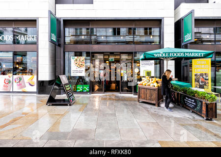 London, UK - September 12, 2018: Whole Foods Market Wholefoods store shop entrance on Glasshouse street with rainy wet day in Soho - Stock Photo