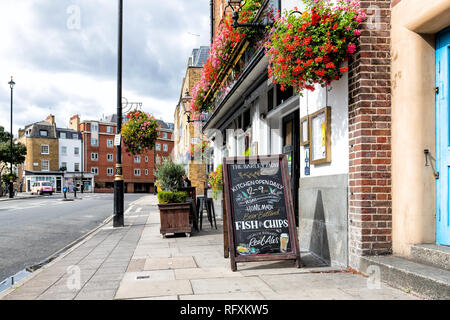 London, UK - September 14, 2018: Neighborhood of Westminster with nobody on pavement street by shops and placard sign for The Barley Mow cafe restaura - Stock Photo
