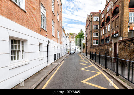 London, UK - September 16, 2018: Neighborhood district of Kensington alley street mews with empty road architecture and nobody - Stock Photo