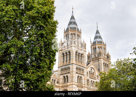 Exterior historic architecture of Natural History Museum in Kensington Chelsea area of London, UK during cloudy summer autumn day looking up and nobod - Stock Photo