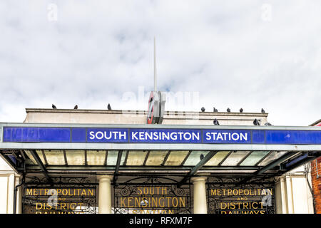 London, UK - September 16, 2018: Neighborhood district of South Kensington street and closeup of underground tube station sign - Stock Photo