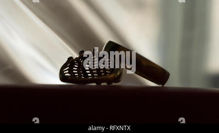 Wedding rings silhouette on table - Stock Photo