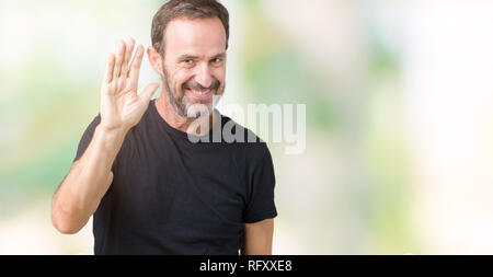 Handsome middle age hoary senior man over isolated background Waiving saying hello happy and smiling, friendly welcome gesture - Stock Photo