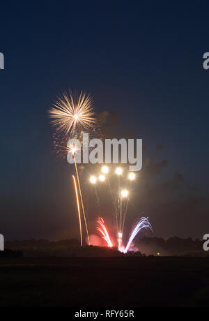 Fourth of July fireworks over small town America.  Peru, Illinois, USA - Stock Photo