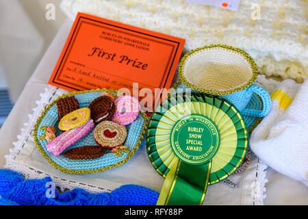 1st prize winning competition entry, certificate & rosette for knitted biscuits & cup handicraft - Gardeners' Show, Burley-in-Wharfedale, England, UK - Stock Photo