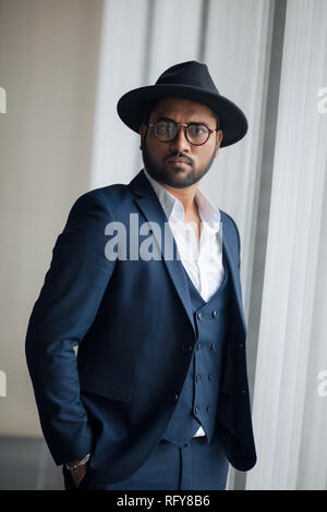 teddy guy. stunning celebrity in a hat - Stock Photo