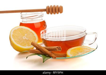 Tea with honey, lemon and cinnamon isolated on white - Stock Photo