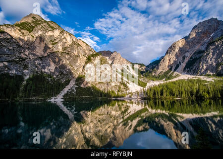 Panoramic view on Lake Prags, Lake Braies, Pragser Wildsee, Lago di Braies, the mountain Seekofel in the distance - Stock Photo
