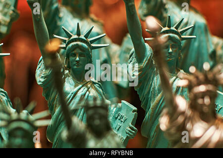 Row with generic Statue of Liberty statues sold as souvenirs in a NYC shop - selective focus. - Stock Photo