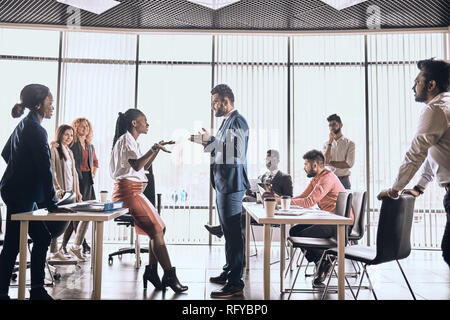 two employees are having a conflict . two views on the problem. - Stock Photo