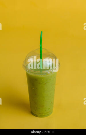 healthy detoxing cocktail from kiwi in glass with a straw - Stock Photo