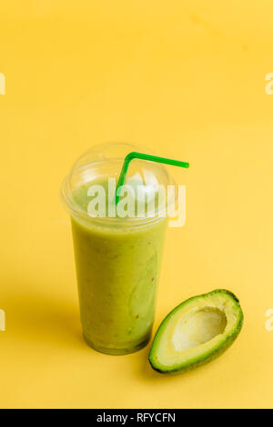 green spinach and kale health smoothie in glasses with a straw - Stock Photo