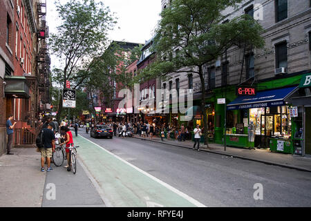 NEW YOR, USA - AUGUST 23, 2017: Unidentified people on the MacDougal street in New York City. This Street in Greenwich Village is most colorful venue  - Stock Photo