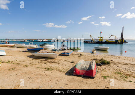 Traditional wooden fishing boats, Santa Luzia, Algarve, Portugal, Europe. - Stock Photo