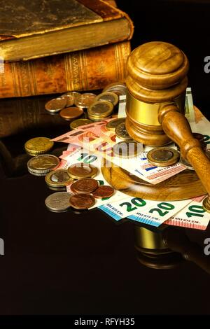 A bribe in court. Corruption in Justice. Judging hammer and euro banknotes. Judgment for money. - Stock Photo