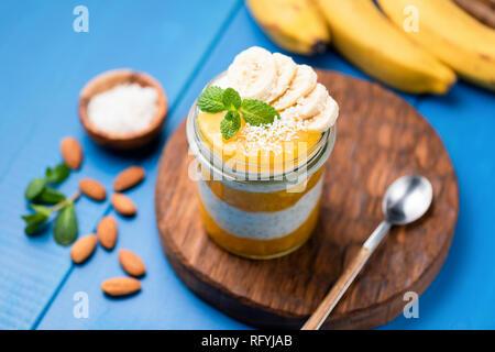 Mango Chia Pudding In Jar. Vegan, Vegatarian food. Selective focus, healthy food concept - Stock Photo