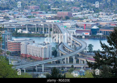 PORTLAND, OREGON - April 14, 2014:  The view from Marquam Hill Upper Tram Station of city buildings and Marquam Bridge over the Willamette River in Po - Stock Photo