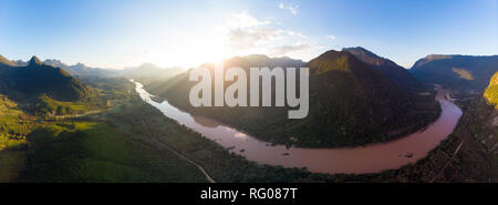 Aerial panoramic Nam Ou River Nong Khiaw Muang Ngoi Laos, sunset dramatic sky, scenic mountain landscape, famous travel destination in South East Asia