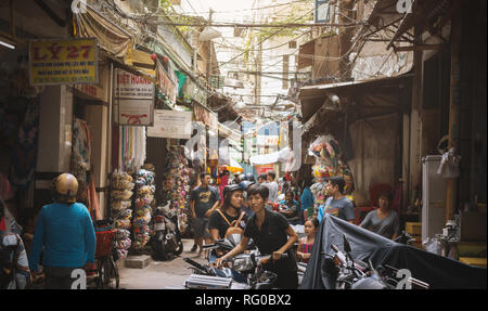 busy crowded asian street market in Vietnam - Stock Photo