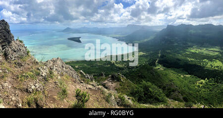 view on ile aux benitiers from the hiking trail to the top of le morne mountain on mauritius island - Stock Photo