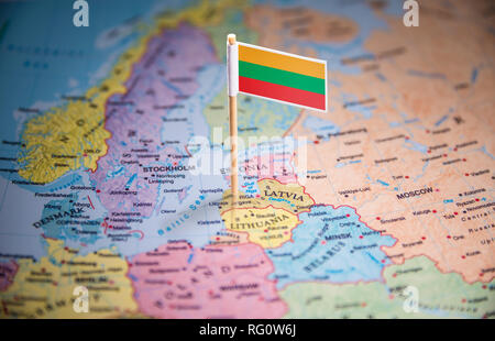 Lithuania marked with a flag on the map - Stock Photo