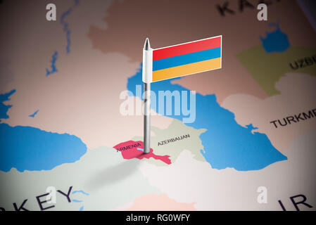 Armenia marked with a flag on the map - Stock Photo