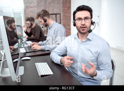 businessman at a video session in the call center - Stock Photo