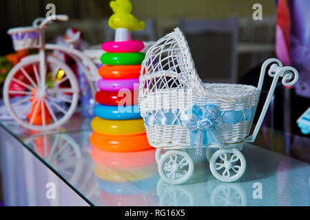 Toy for decoration pink stroller. a small figure of an jewelry box stroller close up - Stock Photo